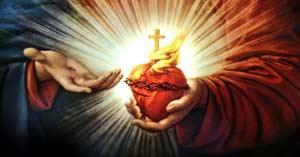 sagrado corazon de jesus sostenido por mano de jesucristo