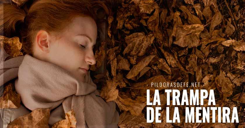 mujer recostada hojas secas la trampa de la mentira el mentiroso